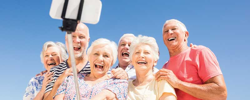 A group of Seniors smiling for a selfie