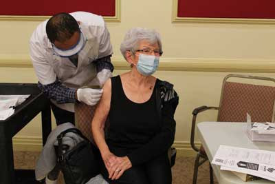 Lois Faulkner a Senior Choice at Home member receives Pfizers COVID-19 vaccine