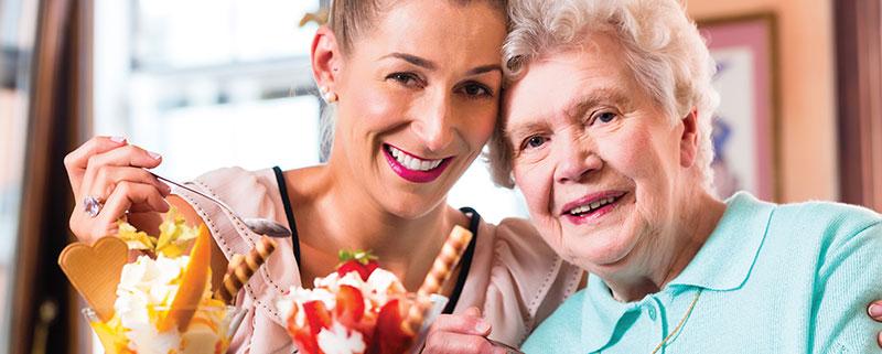 2 ladies eating an Ice Cream Sundae